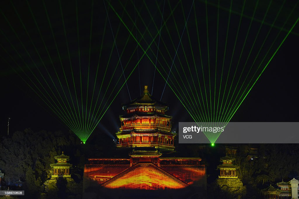 Image show a light show at the Summer Palace prior to a new year count-down event on December 31, 2012 in Beijing, China.