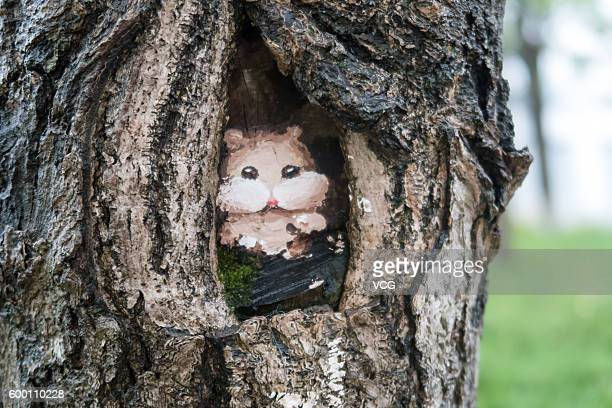 Image shows a painting of squirrel on a tree hole at Jinhai Road Campus Shanghai Second Polytechnic University on September 7 2016 in Shanghai China...