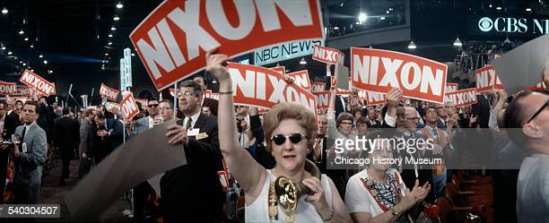 Image shows a panoramic view of a crowd of supporters holding up signs supporting Richard M Nixon at the 29th Republican National Convention in Miami...
