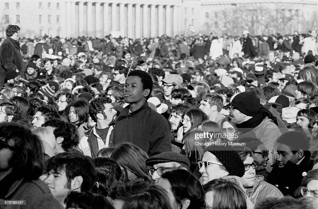 Image shows a view of the crowd gathered for the Moratorium to End the War in Vietnam a nationwide peace demonstration protesting the United States'...
