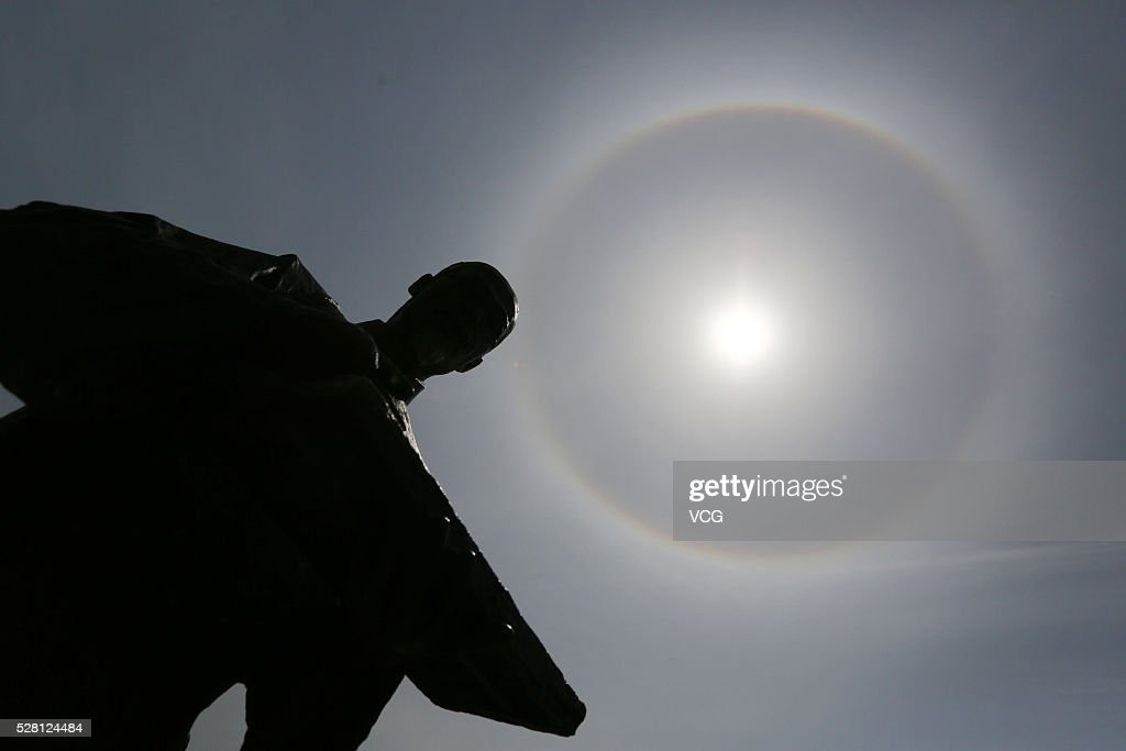 Image shows solar halo appears in the sky on May 4, 2016 in Huangshan, Anhui Province of China. A halo is an optical phenomenon produced by light interacting with ice crystals suspended in the atmosphere, resulting in a wide variety of colored or white rings, arcs and spots in the sky.