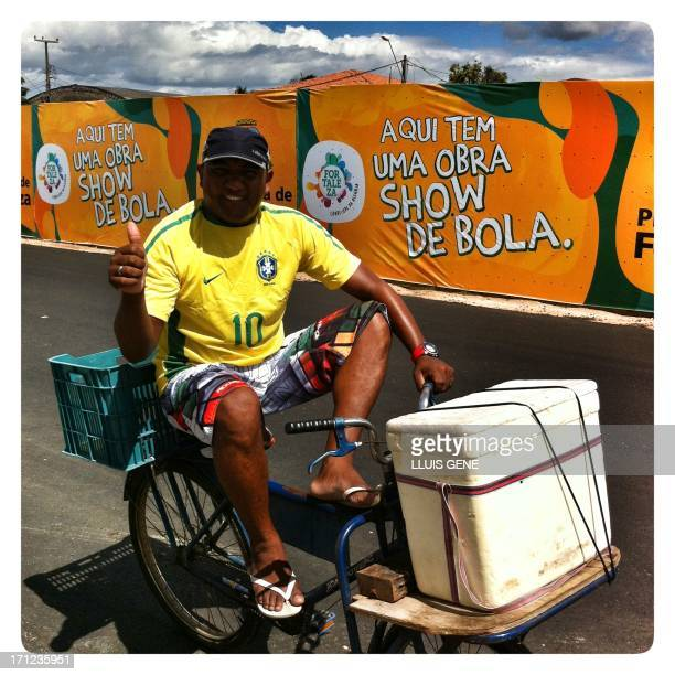 Image taken with a mobile phone showing a street vendor on his bike during of the FIFA Confederations Cup Brazil 2013 in Fortaleza on June 23 2013...