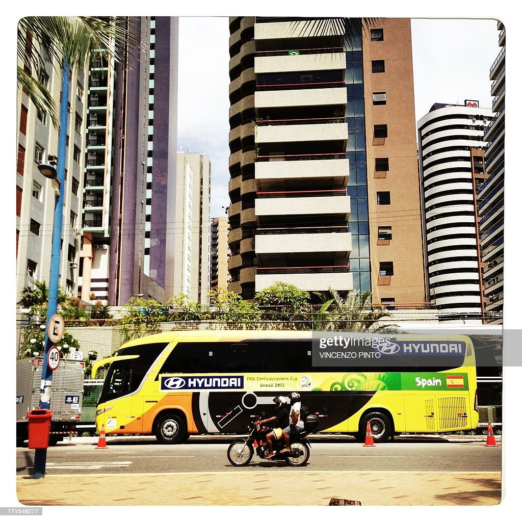 Image taken with a mobile phone showing the Spanish team's bus during the FIFA Confederations Cup Brazil 2013 in Fortaleza, on June 25, 2013. Attention editors : this image is part of a serie of pictures showing the backstage of the Confederation Cup competition and the daily life in Brazil as experienced by AFP photographers covering the event.