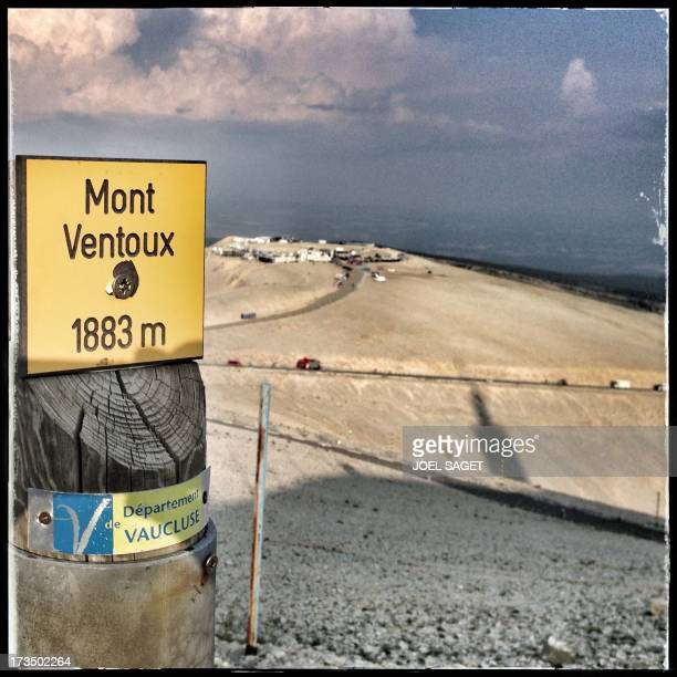 Image taken with a mobile phone shows a placard reading 'Mont Ventoux' at the top of the Mont near the finish line at the end of the 2425 km...