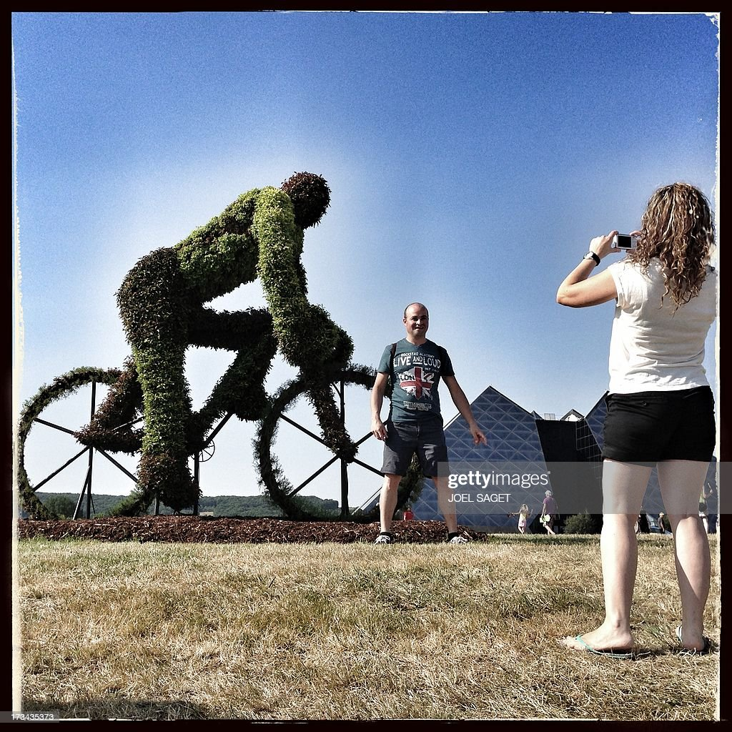 Image taken with a mobile phone shows a sculptured bush representing a cyclist displayed near the finish line at the end of the 173 km thirteenth stage of the 100th edition of the Tour de France cycling race on July 12, 2013 between Tours and Saint-Amand-Montrond, central France.