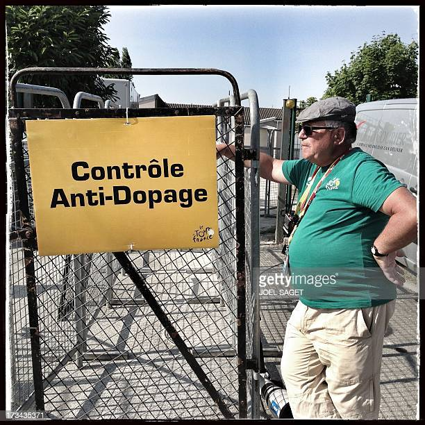 Image taken with a mobile phone shows an ASO staff member standing at the entrance of the antidoping control zone near the finish line at the end of...