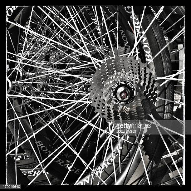 Image taken with a mobile phone shows details of a wheel of a road bike on June 28 2013 in PortoVecchio on the French island of Corsica The 100th...
