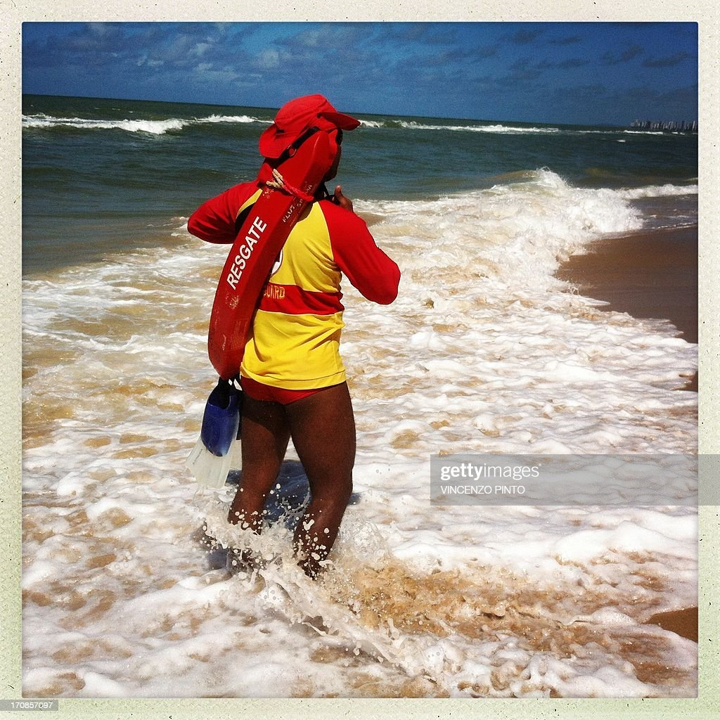 Image taken with an Iphone showing a lifeguard on the beach of Recife during the FIFA Confederations Cup Brazil 2013 June 19, 2013. Attention editors : this image is part of a serie of pictures showing the backstage of the Confederation Cup competition and the daily life in Brasil as experienced by AFP photographers covering the event.