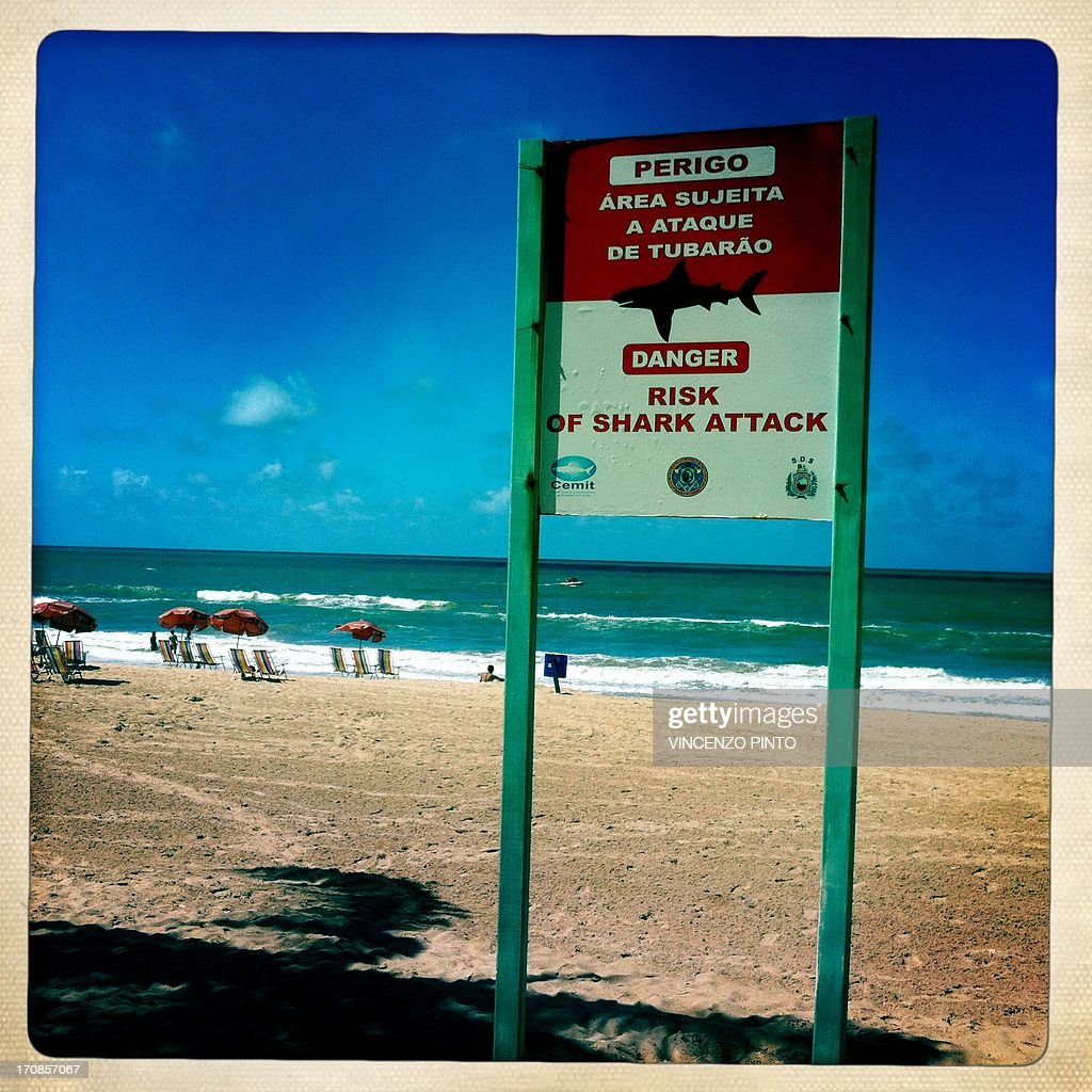 Image taken with an Iphone showing a shark warning sign on the beach of Recife during the FIFA Confederations Cup Brazil 2013 June 19, 2013. Attention editors : this image is part of a serie of pictures showing the backstage of the Confederation Cup competition and the daily life in Brasil as experienced by AFP photographers covering the event.