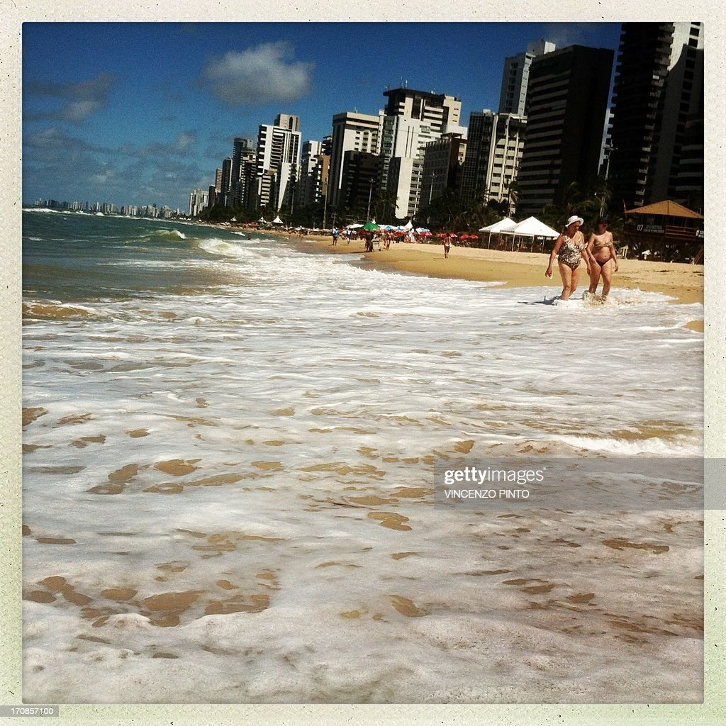Image taken with an Iphone showing the beach of Recife during the FIFA Confederations Cup Brazil 2013 June 19, 2013. Attention editors : this image is part of a serie of pictures showing the backstage of the Confederation Cup competition and the daily life in Brasil as experienced by AFP photographers covering the event.