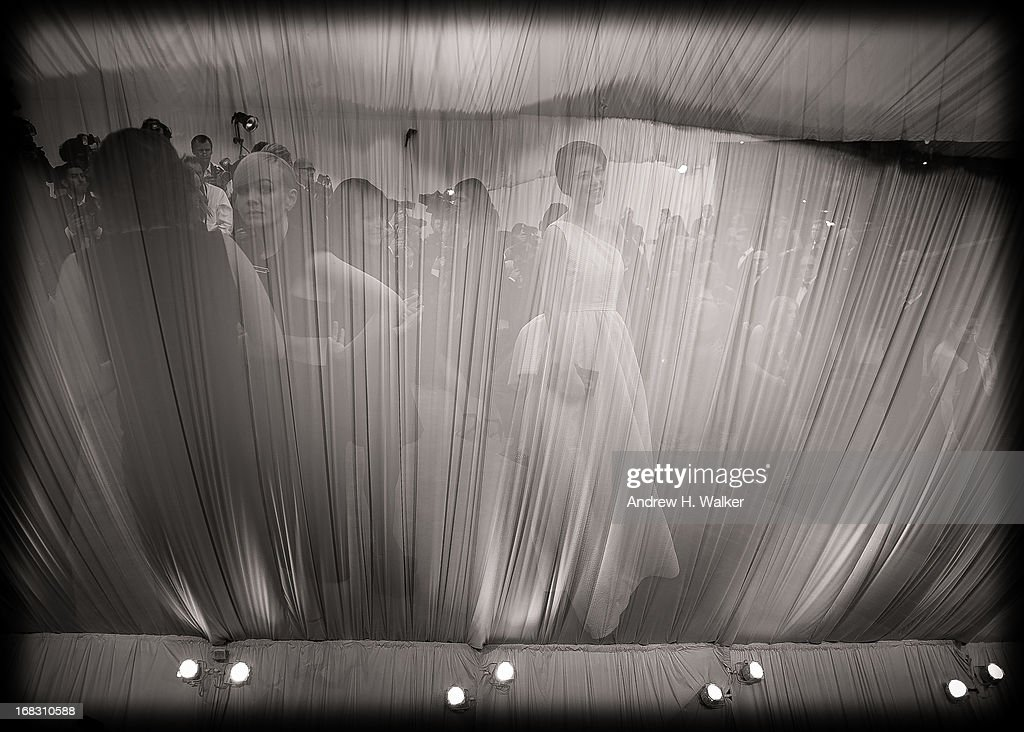 image was double-exposed in camera and has been digitally processed and converted to black and white] Guests attend the Costume Institute Gala for the 'PUNK: Chaos to Couture' exhibition at the Metropolitan Museum of Art on May 6, 2013 in New York City.