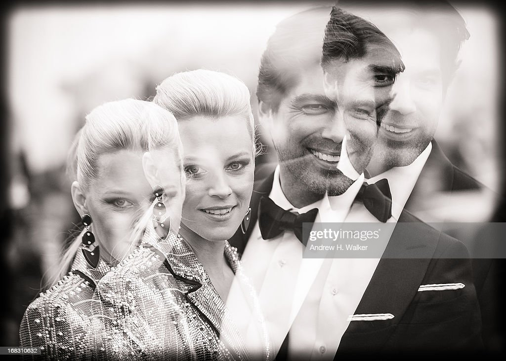 image was double-exposed in camera and has been digitally processed and converted to black and white] Elizabeth Banks and Brian Atwood attend the Costume Institute Gala for the 'PUNK: Chaos to Couture' exhibition at the Metropolitan Museum of Art on May 6, 2013 in New York City.