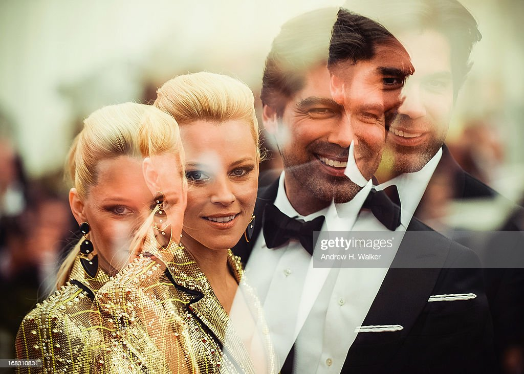 image was double-exposed in camera] Elizabeth Banks and Brian Atwood attend the Costume Institute Gala for the 'PUNK: Chaos to Couture' exhibition at the Metropolitan Museum of Art on May 6, 2013 in New York City.