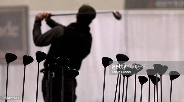 IMAGEFueled by the warm weather golfers took their swings at one of two huge driving ranges at the golf show at the Metro Convention Centre in...