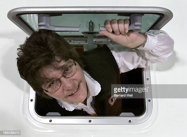 Lori Mason winner of the Canadian Safe Boating Award pops throught the hatch of a Beneteau 331 a 33' sailboat at the Toronto Boat Show January 16...