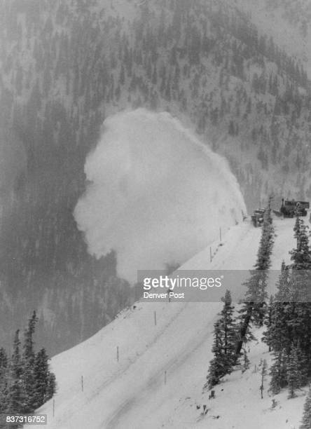 Imagery On Loveland Pass A Colorado State Highway Department snow blower kicks up a rooster tail of snow about noon Friday as it edges the roadway on...
