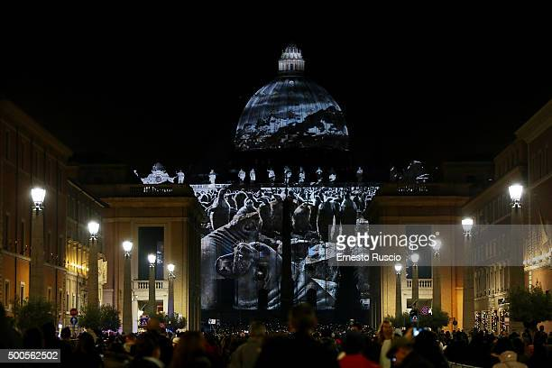Images are projected onto the walls of St Peter's Basilica during a light Installation at St Peter's Square on December 8 2015 in Vatican City...