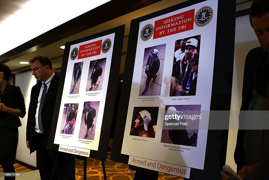 Images are viewed taken from a security camera of persons of interest in the twin bombings at the Boston Marathon during a news conference on April 18, 2013 in Boston, Massachusetts. Authorities investigating the attack on the Boston Marathon have shifted their focus on locating the person who placed a black bag down and walked away just before the bombs went off. The twin bombings at the 116-year-old Boston race, which occurred near the marathon finish line, resulted in the deaths of three people while hospitalizing at least 128.
