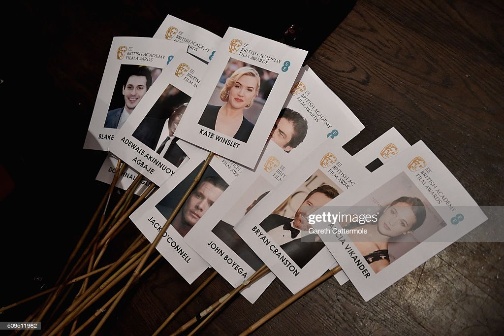 Images of actors are readied to be placed at their assigned seats during the annual BAFTA heads on sticks photocall at The Royal Opera House on February 11, 2015 in London, England. The seating plan is set ahead of the British Academy Film Awards 2015 which takes place on Sunday February 14, 2015.