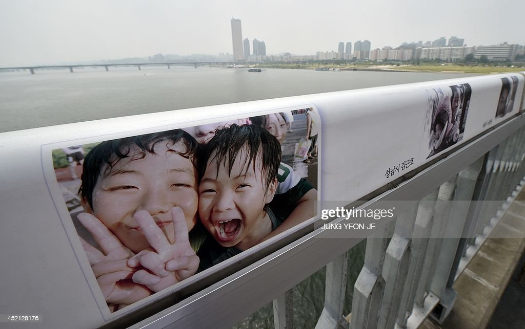 Images of children are displayed along the railing to dissuade potential suicides on Mapo Bridge a common site for suicides over the Han river in...