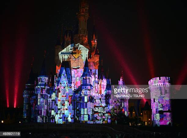 Images of Disney characters are projeted on the Cinderella castle at a press preview of the new attraction 'Once upon a time' at Tokyo Disneyland in...