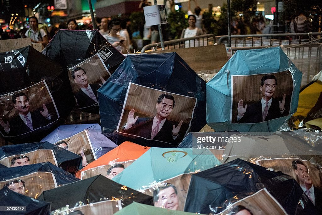 Images of Hong Kong Chief Executive Leung Chunying are pasted onto umbrellas symbols of the Hong Kong prodemocracy protests at a barricade set up in...
