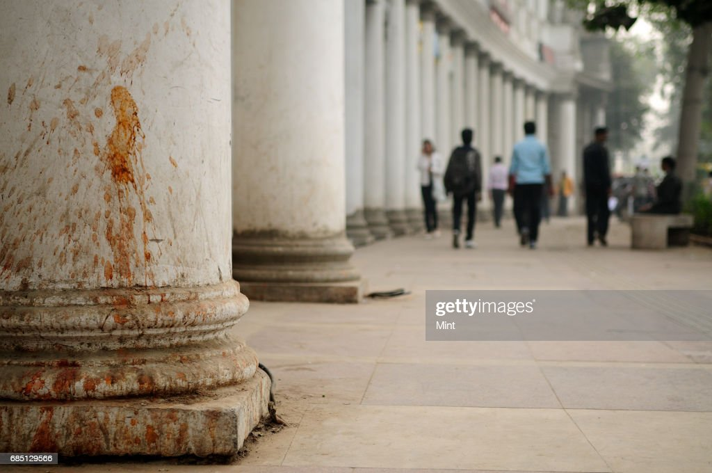 Images of paan-stained walls in Connaught Place. Though the dirty white pillars of the colonial-era arcade were repainted in time for last years Commonwealth Games, every column is again stained blood red by the paan eater.