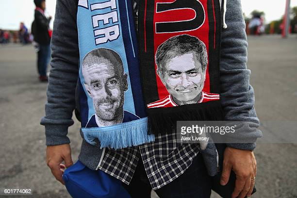Images of Pep Guardiola the manager of Manchester City and Jose Mourinho of Manchester United are seen on a scarf ahead of the Premier League match...