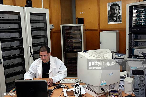 Images of revolutionary Che Guevara are displayed in the office of a scientist at work in the Center for Genetic Engineering and Biotechnology in...