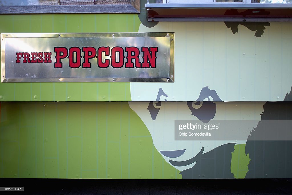 Images of the Smithsonian National Zoological Park's giant pandas is displayed on a popcorn cart the day after the death of a six-day-old panda cub at the zoo September 24, 2012 in Washington, DC. Officials at the zoo released preliminary results from a necropsy peformed on the 6-day-old, 4-ounce female cub that died at the zoo yesterday.