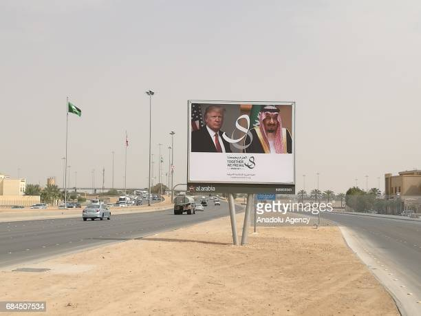 Images of US President Donald Trump are displayed on billboards ahead of Trump's visit to Saudi Arabia in Riyadh Saudi Arabia on May 18 2017 US...
