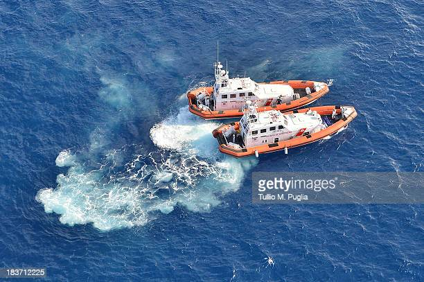 Images taken from a AB412 helicopter with the Second Regiment SIRIO of the Italian Army show Coast Guard units taking part in a search and rescue...