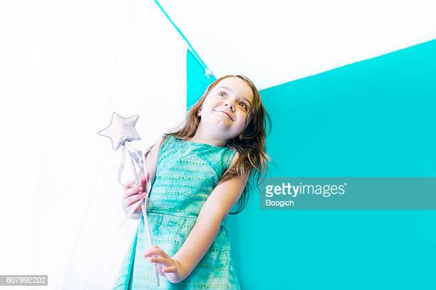 Imaginative Little Girl Plays with Wand Pretending to be Princess
