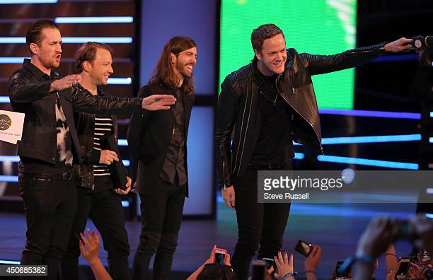 TORONTO JUNE 15 Imagine Dragons accept their award during MMVA 2014 awards show featuring some of the countries best talent on June 15 2014