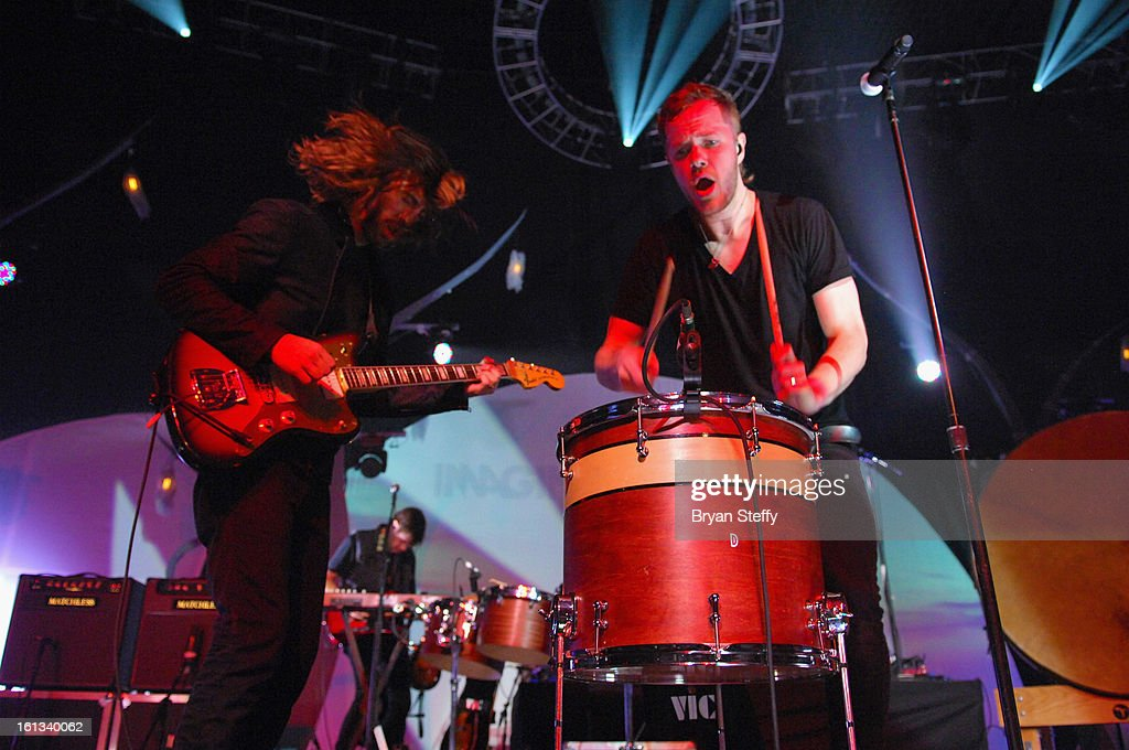 Imagine Dragons guitarist Wayne Sermon (L) and singer/drummer Dan Reynolds perform at The Joint inside the Hard Rock Hotel & Casino as the band tours in support of the album 'Night Visions' on February 9, 2013 in Las Vegas, Nevada.
