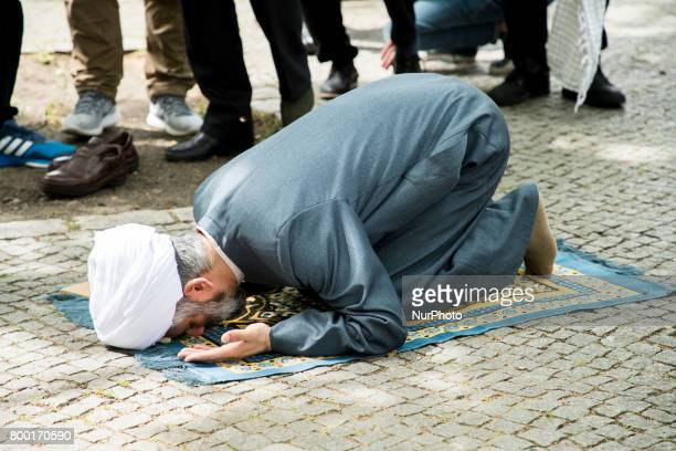 Imam Hamid Reza Torabi and other men pray before the beginning of an AlQudsDay demonstration in Berlin Germany on June 23 2017