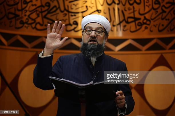 Imam Irfan Chishti addresses worshippers as they attend Friday prayers at Manchester Central Mosque where they prayed for the victims and injured in...