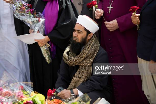 Imams and members of the Muslim community arrive to lay flowers near the scene of the London Bridge terrorist attacks on June 7 2017 in London...