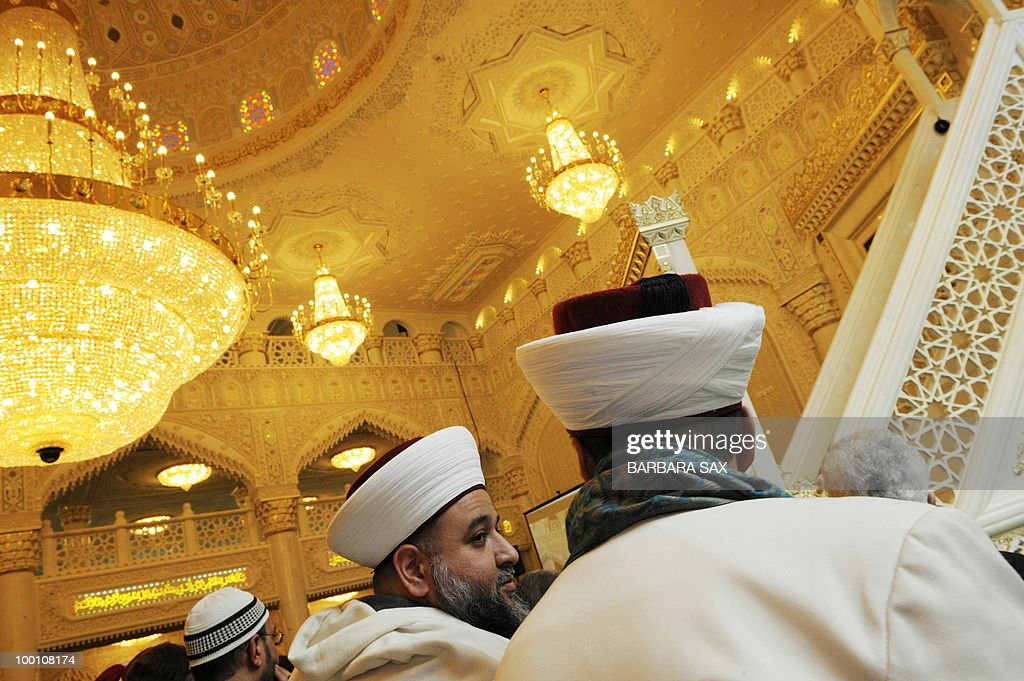 Imams attend a service to inaugurate the new Omar Mosque in Berlin's Kreuzberg district during the inauguration of the Islamic Maschari Centre on May 21, 2010. The centre includes the mosque, a kindergarden, a school, a library, a travel agency and a shopping centre.