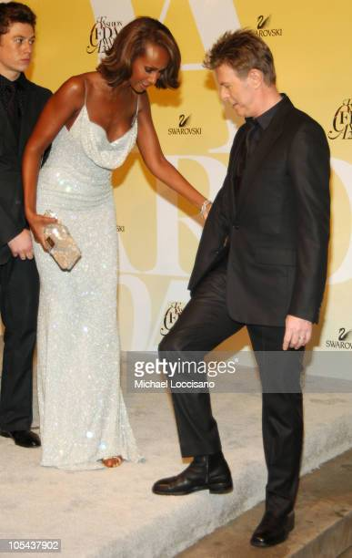 Iman and David Bowie during 2005 CFDA Fashion Awards Arrivals at The New York Public Library in New York City New York United States