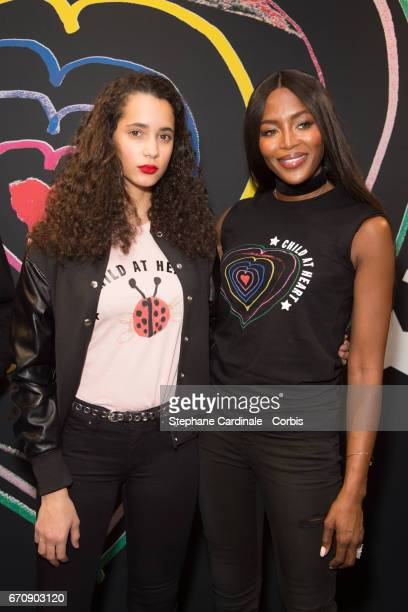 Iman Perez and Naomi Campbell attend Fashion For Relief 'Child At Heart' cocktail party on April 20 2017 in Paris France The 'Child At Heart'...