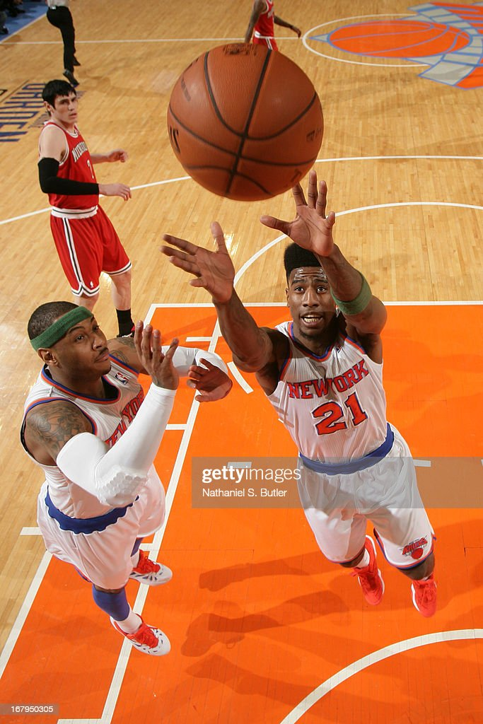 Iman Shumpert #21 and Carmelo Anthony #7 of the New York Knicks go up for a rebound against the Milwaukee Bucks on April 5, 2013 at Madison Square Garden in New York City.