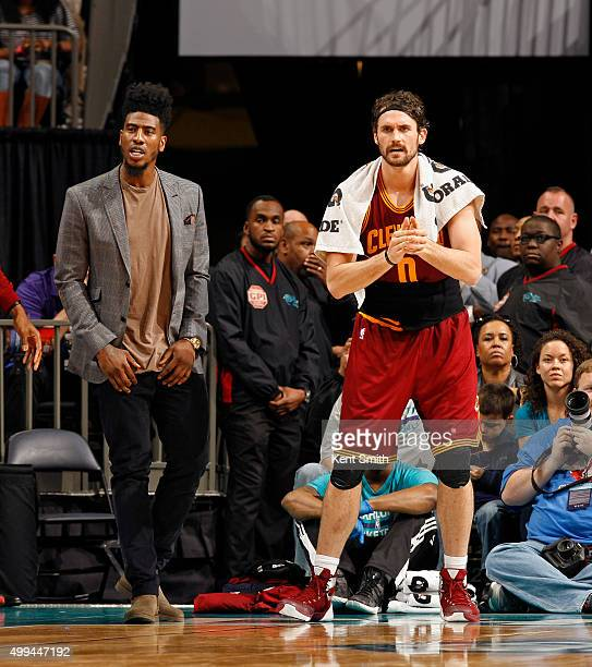 Iman Shumpert and Kevin Love of the Cleveland Cavaliers cheer from the bench during the game against the Charlotte Hornets at the Time Warner Cable...