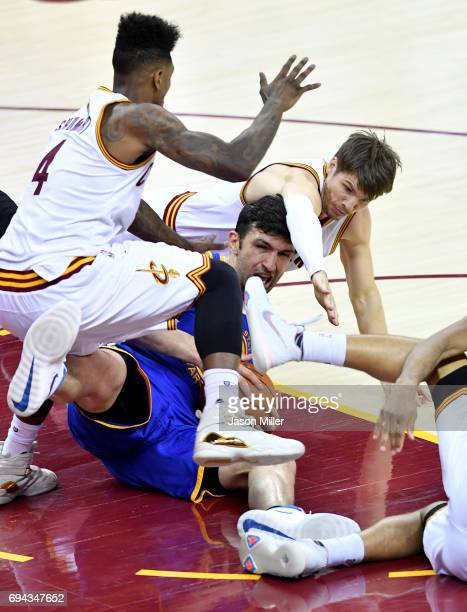 Iman Shumpert and Kyle Korver of the Cleveland Cavaliers compete for the ball with Zaza Pachulia of the Golden State Warriors in the third quarter in...