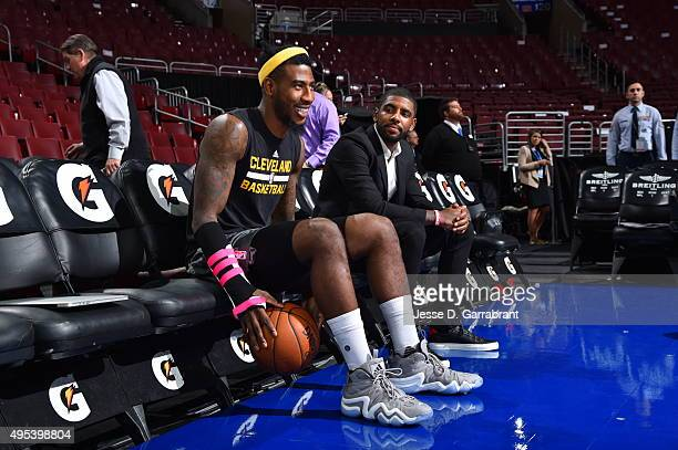 Iman Shumpert and Kyrie Irving of the Cleveland Cavaliers look on against the Philadelphia 76ers at Wells Fargo Center on November 2 2015 in...