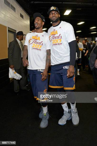 Iman Shumpert and LeBron James of the Cleveland Cavaliers walk off the court after winning Game Five of the Eastern Conference Finals against the...