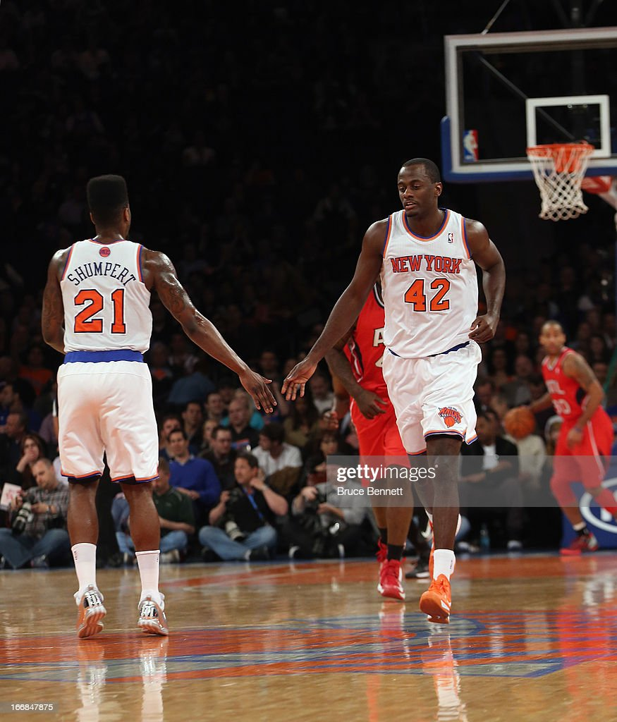 Iman Shumpert #21 congratulates Earl Barron #42 of the New York Knicks on his first basket against the Atlanta Hawks at Madison Square Garden on April 17, 2013 in New York City. The Knicks defeated the Hawks 98-92.