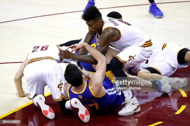 Iman Shumpert Deron Williams and Kyle Korver of the Cleveland Cavaliers compete for the ball with Zaza Pachulia of the Golden State Warriors in the...