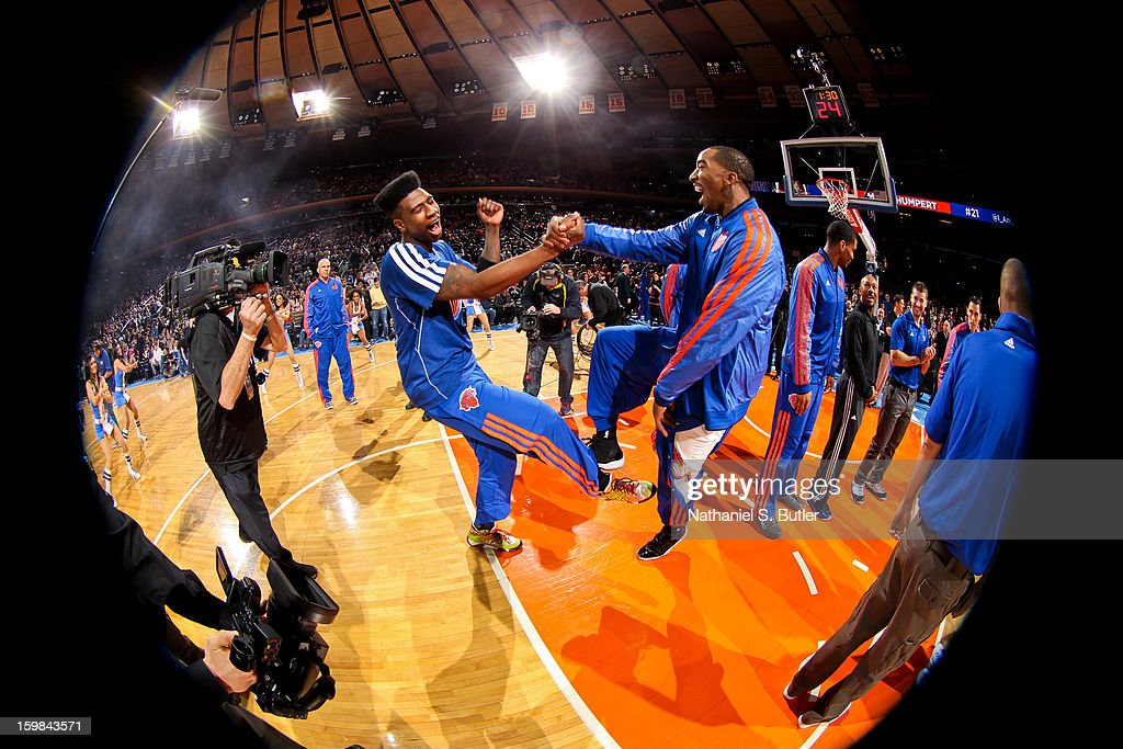 Iman Shumpert #21 greets teammate J.R. Smith #8 of the New York Knicks before playing the Brooklyn Nets on January 21, 2013 at Madison Square Garden in New York City.