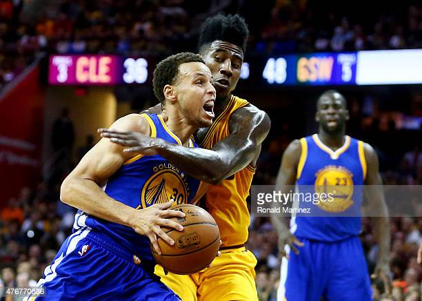 Iman Shumpert of the Cleveland Cavaliers blocks a shot by Stephen Curry of the Golden State Warriors in the second quarter during Game Four of the...